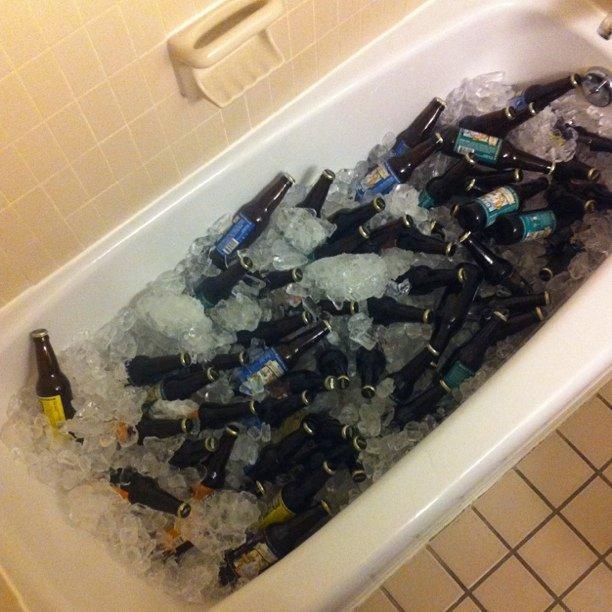 Hey, look. It's a bathtub full of beer. Suite 1906 @ 8:00! #pycon #qhire