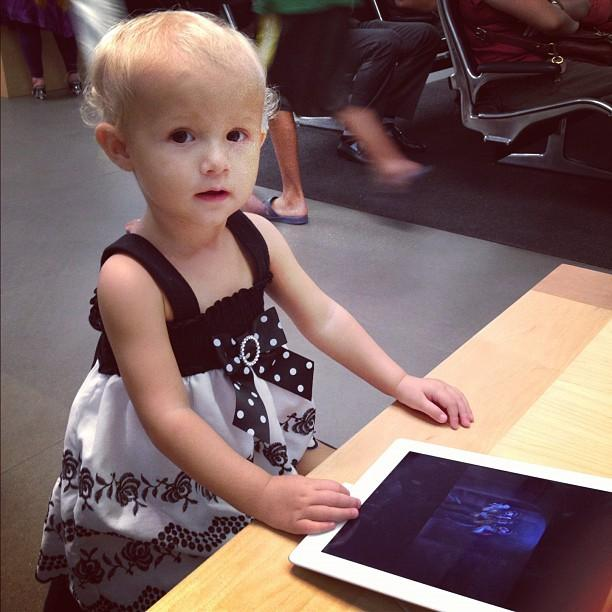"Colette at the Apple Store. She now knows how to say ""iPad."" Daddy is proud!"