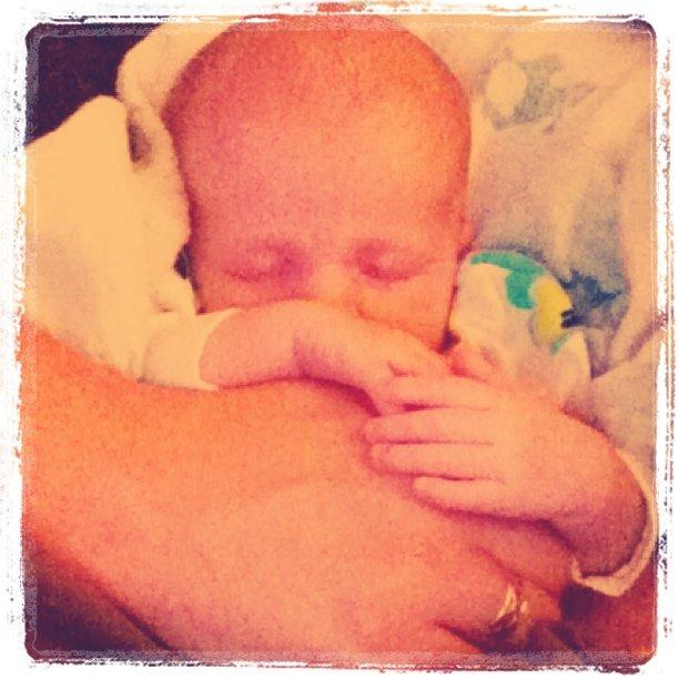 Feeling safe in Daddy's arms.