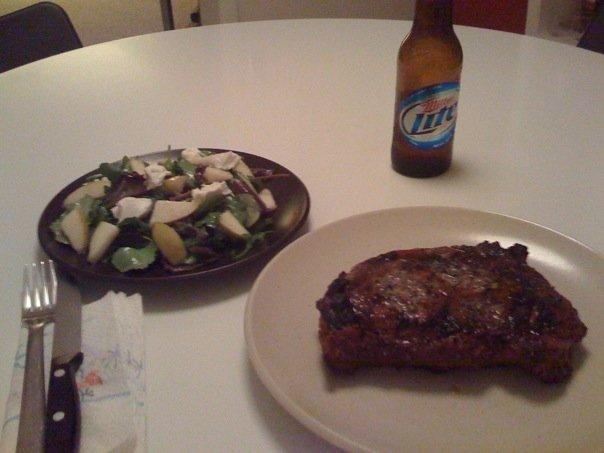 Dinner for the bachelor. Nothing like a medium rare ribeye and a beer.