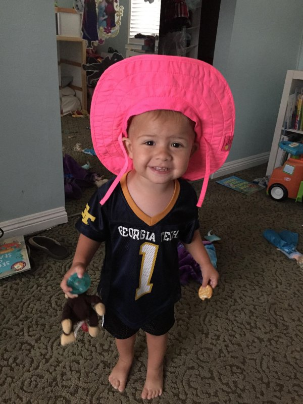 William loves the Yellow Jackets... and pink hats.