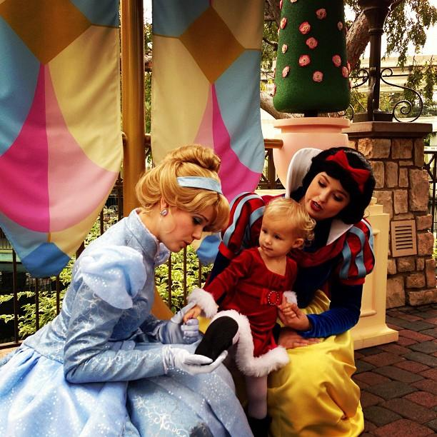 Colette showing Cinderella and Snow White her Christmas boots.