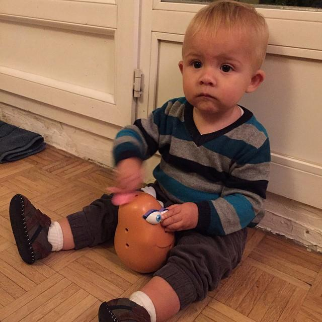 William playing with Monsieur Patat — the French Mister Potato Head.