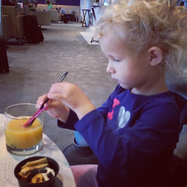Chilling in the @Delta SkyClub with this kiddo. Wish daddy luck on his first solo flight with Colette!