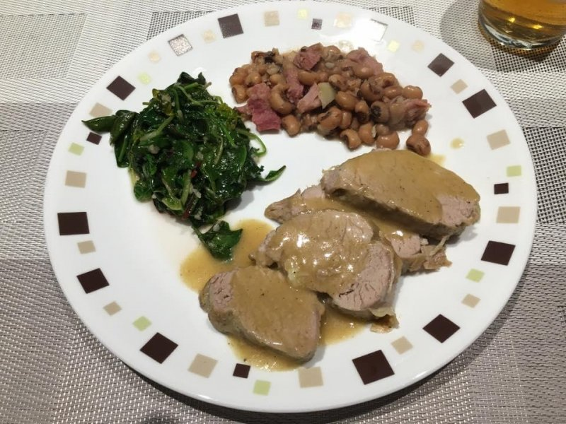 Lazy Saturday dinner. Pork tenderloin, black eyed peas with ham, and sautéed greens. The south comes out in me when I need comfort food!