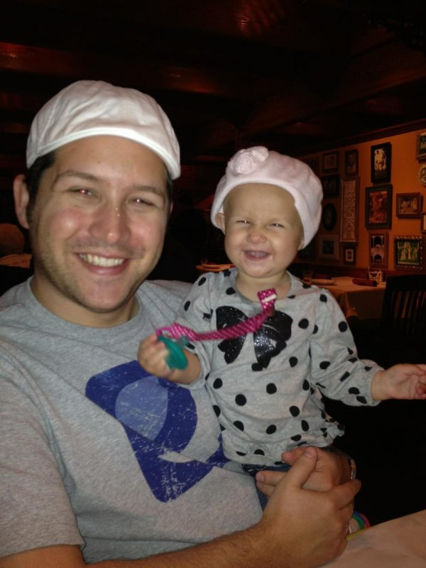 Daddy and baby sporting their hats at dinner tonight.