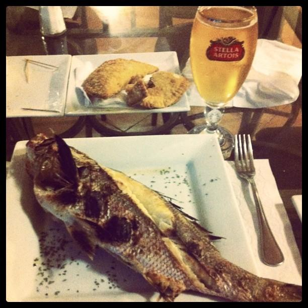 Grilled whole red snapper and an ice cold beer.